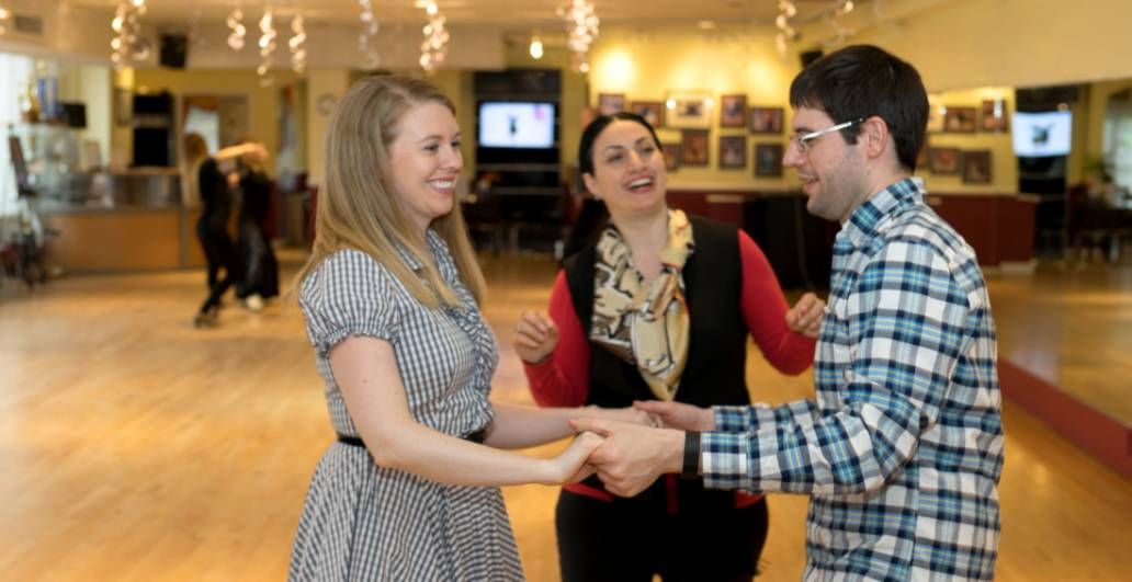 Couple dance lesson at Chevy Chase Ballroom